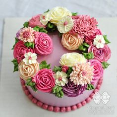 Floral/Flower Buttercream Cake...wreath style.  Amazingly beautiful and HUGE roses.  Great colors.