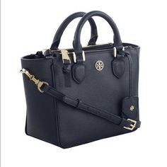 """Tory Burch Robinson Pebbled Mini Square Tote Navy Bag is color navy. In great condition. Only thing there is some small marks on the zipper handle & a small white mark at the bottom in the front (see last pic) Hardly noticeable. Comes with dust bag, strap to wear cross body. Silver hardware. Leather.  Two zippers at front & back.  Open compartment at center with magnetic snap.  Interior center open pocket with zipper compartment and two open pockets. Top leather handles with 3"""" drop. Height…"""