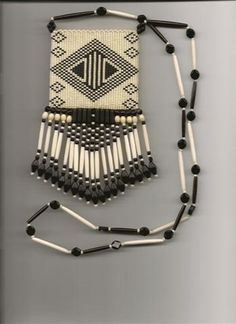 I have a beadwork medicine bag very much like this except it's done in dark brown and deep purple beads.