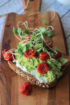 A perfect healthy open faced sandwich option with tangy goat cheese, creamy avocado, roasted cherry tomatoes, and bean sprouts.