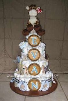HOmemade Baby Boy Diaper Cake... This website is the Pinterest of diaper cake ideas