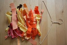 Ribbon Wreath... Use a hanger as your shape!!