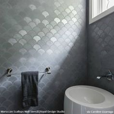 Modern gray bathroom features walls clad in gray metallic fishscale tiles lined . - Modern gray bathroom features walls clad in gray metallic fishscale tiles lined with a modern white - Grey Bathroom Tiles, Grey Bathrooms, Small Bathroom, Bathroom Sinks, Bathroom Wallpaper, Bathroom Ideas, Modern Wallpaper, Country Bathrooms, Bathroom Modern