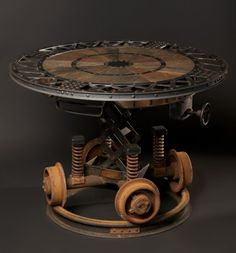 Industrial Revolution Table by Cory Barkman. Steampunk Decor We Love at Design Connection, Inc. | Kansas City Interior Design http://designconnectioninc.com/blog/ #Steampunk #InteriorDesign