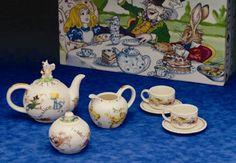 Alice in Wonderland Miniature Tea Set  at Roses and Teacups. I love the Alice in Wonderland sets! They are so cute!