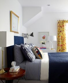 striped bedding. navy and yellow. yellow curtains. emily henderson.
