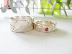Custom Wedding Bands  Sterling silver, sunstone, sapphire.  www.mckenziemendel.com