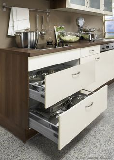 Idea of the Day: Modern Cream-Colored Kitchens. (By ALNO, AG). Fantastic, two tone antique white medium wood brown walls drawers Kitchen Organization, Organization Hacks, Kitchen Storage, Kitchen Decor, Kitchen Ideas, Modern Kitchen Design, Modern House Design, Cream Colored Kitchens, Pan Storage