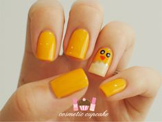 If you can draw dots, a triangle, and a squiggly line then you can totally master this cute manicure. #Easter