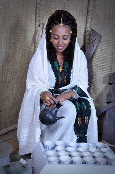 Ethiopia is the land of the beginning,It is a cradle of man kind,the origin place of coffee  Photo: Ethiopian girl in Traditional coffee ceremony with Ethiopian costume.