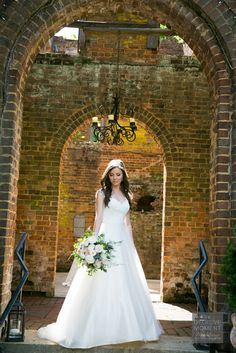 Stunning bride with garden style bouquet featuring peonies and David Austin garden roses at Barnsley Gardens