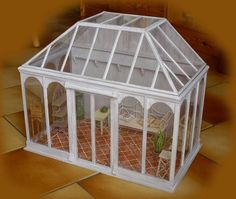 Greenhouse. She made this with plexiglass, cardboard and some wood.