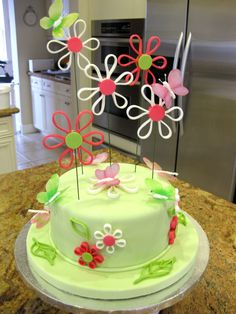 Quilled, butterflies, and dragonflies cake.