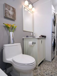 After: Here's the completed washroom. The homeowner opted for a renovation plan that maintained a three-bedroom layout and a variety of new features. This space smartly combines a washer/dryer station with a half bath.