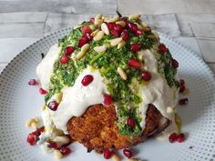 HARISSA-ROASTED CAULIFLOWER WITH HERBS & TAHINI YOGURT - a nutrient-dense plantbased meal.