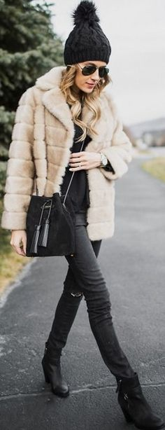 Christine Andrew is rocking the fur coat trend! Through pairing a vintage style faux fur with a black sweater and matching jeans, this otherwise simple look is given a glamorous twist. We love it!  Sweater: Old Navy, Coat/Jeans: Nordstrom, Boots: Vince Camuto. Winter Looks. #christine