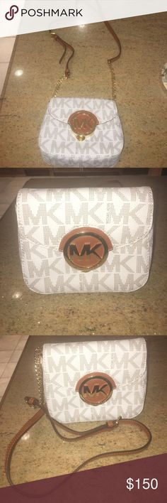 Michael Kors Fulton flap bag Brand new never worn. White and tan MK bag with logo. Can be worn as a crossbody or regularly. Chain and leather strap. Magnetic clasp closure. Does not come with tags Michael Kors Bags Crossbody Bags