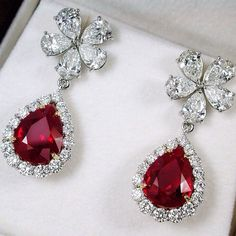 Prima Gems. Burmese Pigeon's Blood Pear Shape Ruby weighing 4.02&4.15cts and 4.81cts with Diamonds Earrings