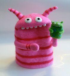 Felted monster finger puppet holding his own little felted monster puppet :D