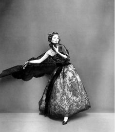Suzy Parker wearing a gown by Dior, photographed by Richard Avedon.