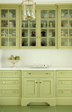 Celery Green Cabinetry Hmmm need to see whole room, how would it look open to living room etc? CHANGED MY MIND! What was I thinking!!!? Can't do white, don't want BORED WITH BEIGE! Yellow good for accents like fresh flowers in a vase. Neon hunter orange, here we come. Good grief, just kidding, camo pink? ;) ;)
