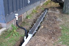 Installation of channel drain system (Dura Slope by NDS) for in-ground gutter system.