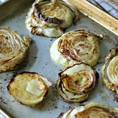 Garlic Roasted Cabbage Steaks Ingredients        1 (approx 2lb) head of organic green cabbage, cut into 1″ thick slices      1.5 tablespoons olive oil      2 to 3 large garlic cloves, smashed      kosher salt      freshly ground black pepper      non-stick cooking spray