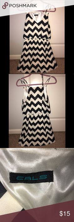 Black & cream chevron dress Cinched at waist, satin like material. Lined on the inside. Cals Dresses