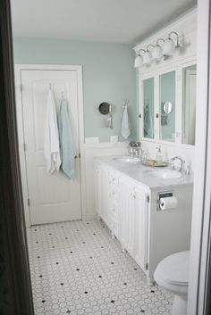 love the wall color and the distressed cabinets--how would this work with our off white tub/sinks/toilet?