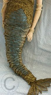 Absolutely amazing mermaid boudoir doll! Scales of silk that changes color by light...