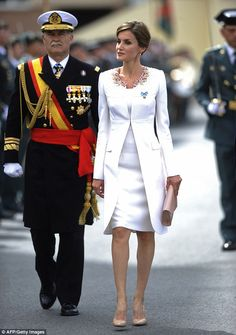 The 42 year old looked stunning in a white dress and matching white dress coat, that came with a detailed jewelled collar