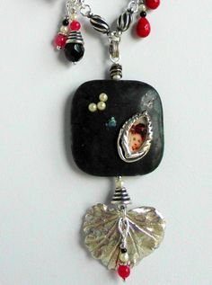 A close up of the Obsidian Stone focal.  Kate of Mulligan Stew Jewelry.