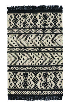 Capel Rug's Kahlo collection - Inspired by Mexican artist Frida Kahlo. Great patterns and fringe elements for any room of the house.