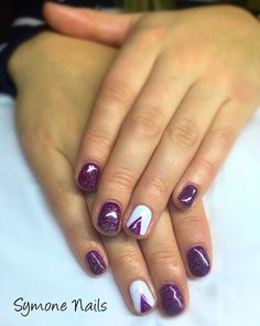 Everyone knows I'm mad on Christmas decoration and Christmas nails are no exception! Here's Nicola's first ever visit to Symones Nails where we've used @gel_two Midnight Bliss see purple with a gentle sparkle on top. The index fingers are Arctic White with hand painted Christmas trees in Midnight Bliss, Sparkles and Konad stamping stars. The whole look is finished off with @gel_two Extreme Shine top coat #christmastrees #symonesnails #nailart #christmasnails  #purplenails #glitternails