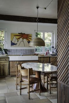 Kitchen with chairs and tables designed by Lionel Jadot. Reclaimed wood, Italian tiles on wall and old French stones on floor #kitchen #interiordesign #bespoke Pic: Serge Anton