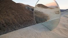 Cody William Smith - Uses circular mirrors to play with perspective and reflection. Images within images. love this its really simple but it creates stunning images.