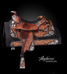 """The Ultimate Show Saddle.All hand engraved solid sterling silver with intricate scroll carving. An inlaid buffalo 16.5"""" pleasure seat and a wide tree. Ready to show with matching wear leathers. $23,000"""