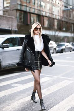 this street style is totally cute- the black and white is sort of feminine and fierce, the tight skirt is kinda sexy and paired with the translucent tights it's perfect for a windy sort of day, and the coat draped around her shoulders adds a kind of loose look to the whole thing