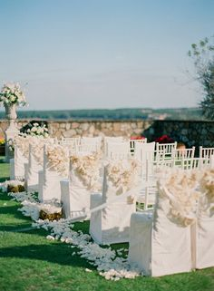 Ceremony chair decor idea | Photo by KT Merry
