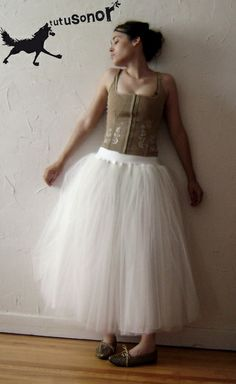 --------ROMANTIC TUTU-------  tutu in white ivory fine tulle.  4 layers of tulle + 1 lining.  Waist band in white jersey.
