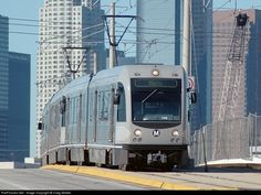 A Los Angeles Metro Breda P2550 light rail vehicle, #715, is seen here crossing the Los Angeles River on the First Street bridge, with downtown Los Angeles looming in the background. The southeastern leg of Los Angeles Metro's Gold Line, connecting downtown's Union Station with East L.A., opened on November 15, 2009. The line now forms a C shape, with light rail trains running from Pasadena southwest to Union Station, then southeast to East Los Angeles via Little Tokyo and Boyle Heights.