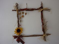 Rose stems, ribbon, beads and dried flowers