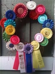 I have so many horse show ribbons stuffed in boxes and drawers. Now I know what I can do with them; make a ribbon wreath.