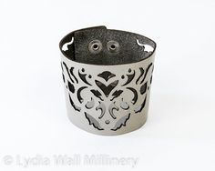 7 1/2 Leather cuff made of metallic Silver leather laser cut in intricate design inspired by Victorian times.    Measures 7 1/2, 8 or 8 1/2