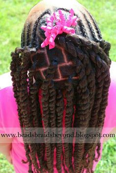Beautiful braids and twists. Love her bow. Pink too!
