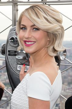 Julianne Hough Lights The Empire State Building Pink In Honor Of Plan International USA at The Empire State Building on October 10, 2014 in New York City.