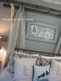 An Old Ladder Re-purposed as a Bed Canopy -- frame: use my arch with A M E N in four squares -