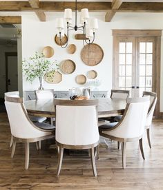Farmhouse Dining Room with Rustic Wood Beans and Large Round Wooden Table Dining Room table Dining Room Remodel, Dining Room Small, Dining Room Walls, Round Kitchen Table, Dining Table, Room Remodeling, Dining Room Inspiration, Dining Chairs, Large Dining Room