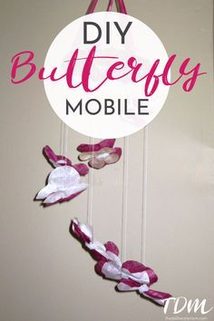 Want a unique mobile for your baby's room? Check out this unique baby room decor idea! A DIY butterfly mobile which only requires a handful of supplies! #babyroomdecor #babyroom #diyproject