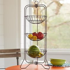 "AMéLIE THREE TIER EPERGNE -- For decorative storage of fruit, snacks, flowers or anything you desire. Trays conveniently removable. Sturdy powder-coated iron. Imported. 14""W x 14""D x 32""H."